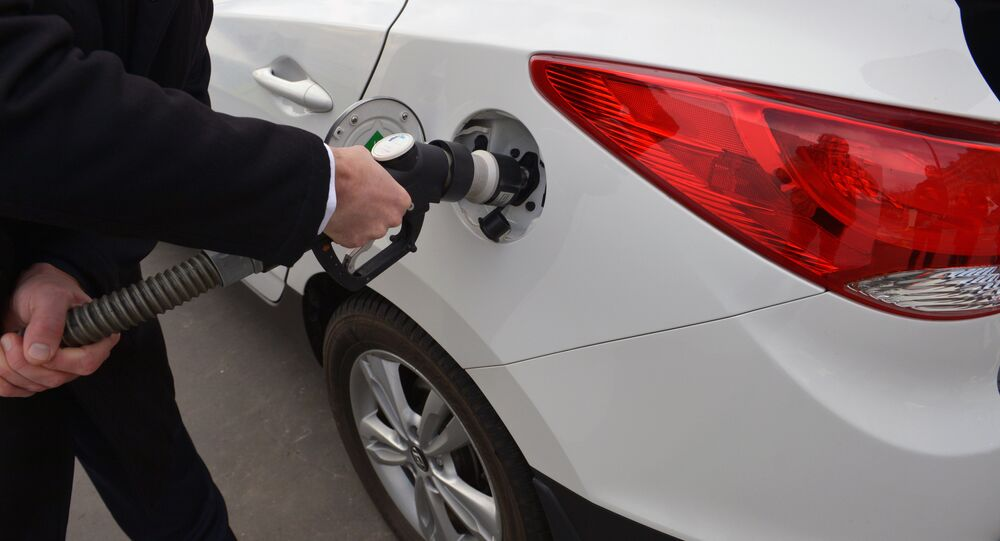 A photo taken on December 3, 2015 shows an ix35 Fuel Cell vehicle by Korean car manufacturer Hyundai at a short time Air Liquide hydrogen temporary station during an demonstration by Hyundai France on the Place de l'Alma in Paris