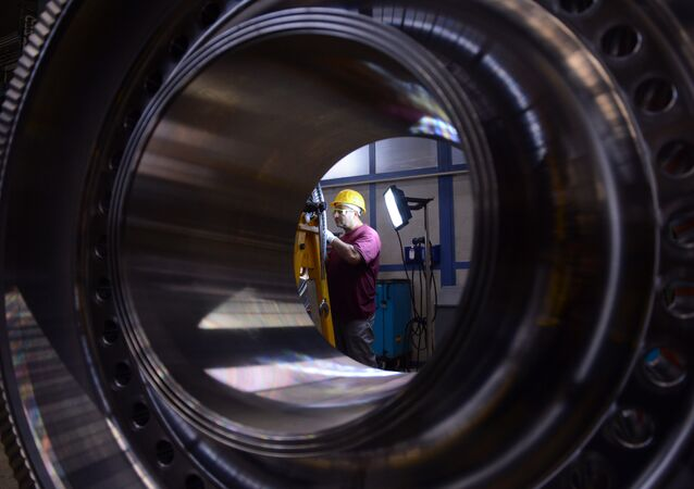 An employee of German industrial giant Siemens works on a rotor at their Gas turbine plant on November 8, 2012 in Berlin