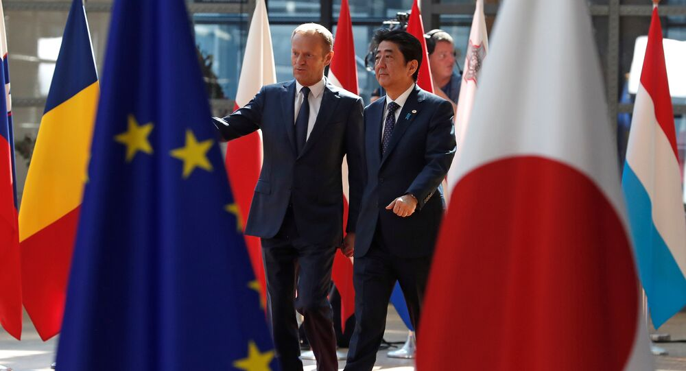 Japan's Prime Minister Shinzo Abe (R) is welcomed by European Council President Donald Tusk at the start of a European Union-Japan summit in Brussels, Belgium July 6, 2017