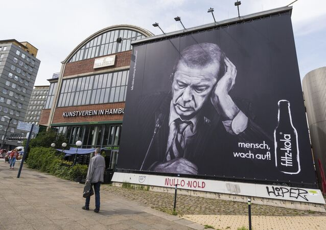 An advertising board of the beverage producer Fritz Kola depicting Turkish president Recep Tayyip Erdogan can be seen in Hamburg, Germany, Thursday, June 29. 2017