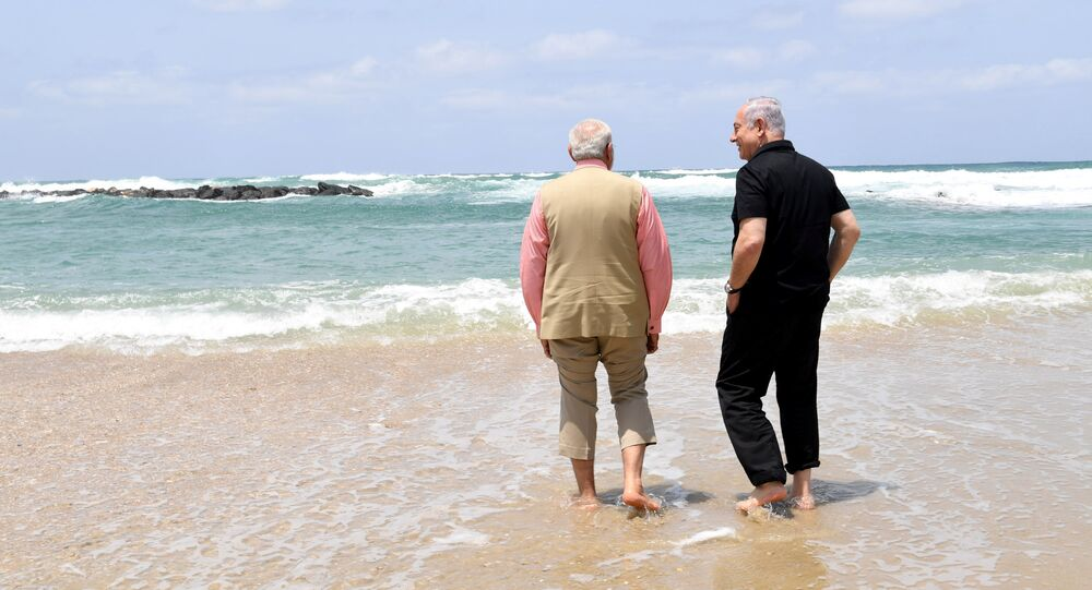 Israel's Prime Minister Benjamin Netanyahu (R) walks with India's Prime Minister Narendra Modi, as they visit Olga Beach and a water desalination unit operated by G.A.L. Water Technologies, near Hadera, Israel July 6, 2017