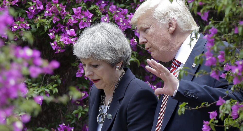 US President Donald Trump, right, talks with British Prime Minister Theresa May.