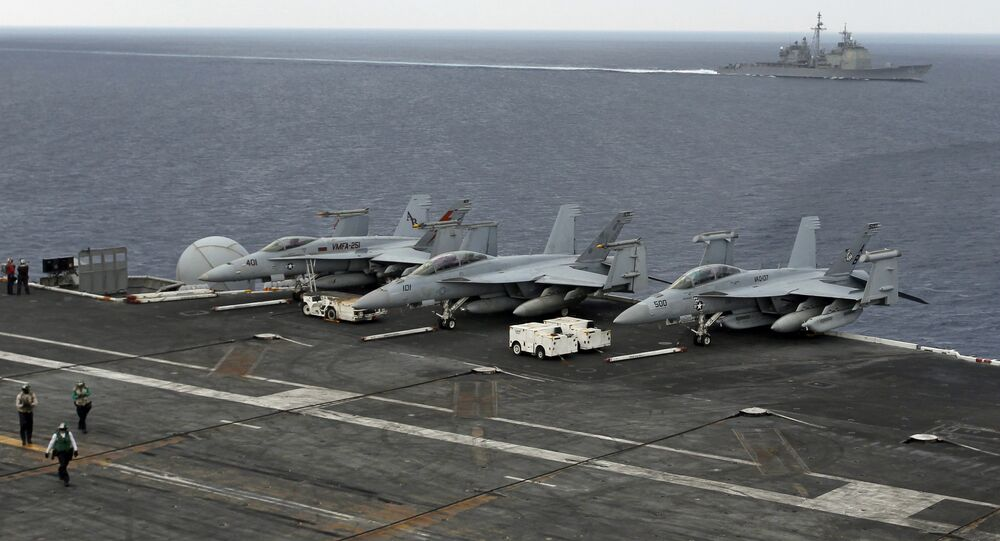 (File) The USS Normandy sails in the Bay of Bengal as U.S. Navy fighter aircrafts are stationed at the flight deck of aircraft carrier USS Theodore Roosevelt (CVN 71) during Exercise Malabar 2015, some 152 miles off eastern coast of Chennai, India, Saturday, Oct. 17, 2015