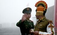 This file photo taken on July 10, 2008 shows a Chinese soldier (L) next to an Indian soldier at the Nathu La border crossing between India and China in India's northeastern Sikkim state