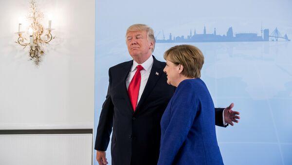 German Chancellor Angela Merkel meets U.S. President Donald Trump on the eve of the G-20 summit in Hamburg, Germany, July 6, 2017 - Sputnik International