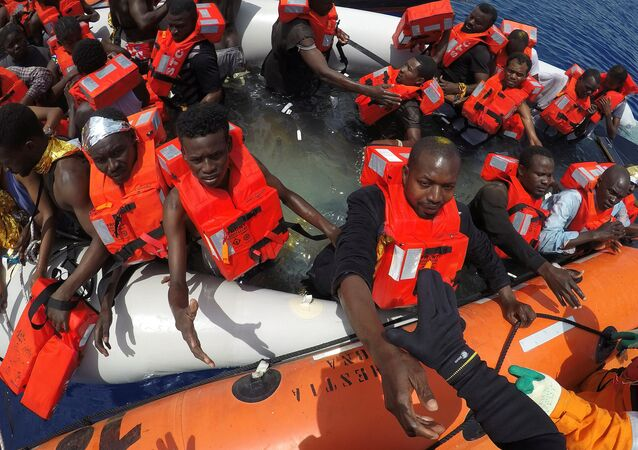 Migrants on a dinghy are rescued by Save the Children NGO crew from the ship Vos Hestia in the Mediterranean sea off Libya coast, June 17, 2017