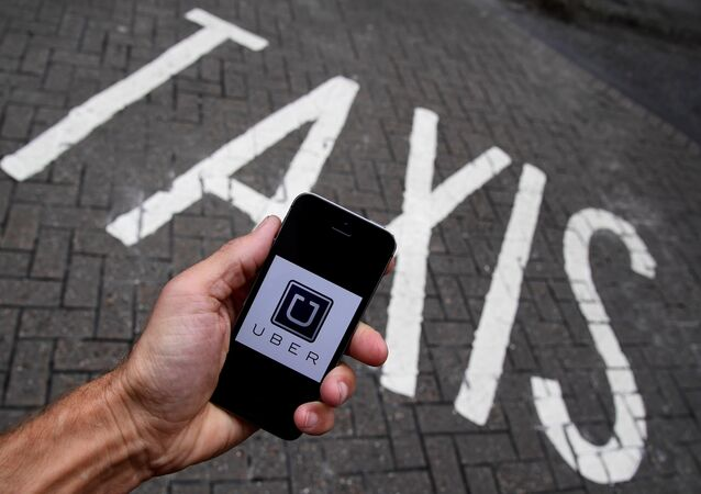 A photo illustration shows the Uber app logo displayed on a mobile telephone. (File)