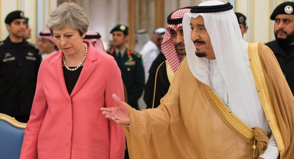 In this photo released by the Saudi Press Agency, SPA, Saudi King Salman welcomes British Prime Minister Theresa May, in Riyadh, Saudi Arabia, Wednesday, April 5, 2017.