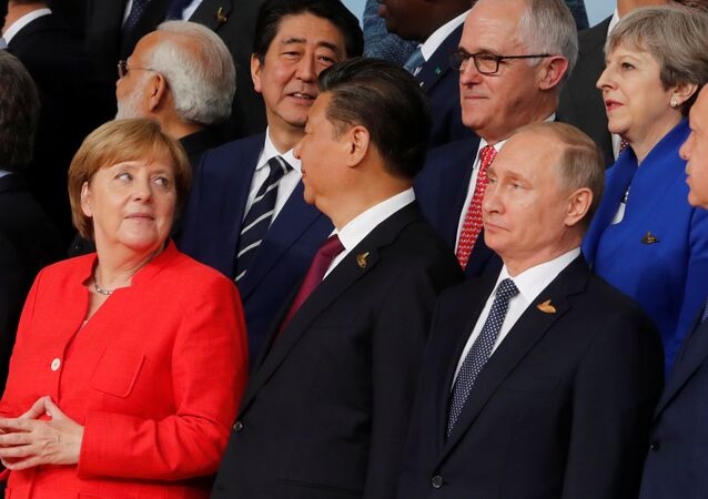 German Chancellor Angela Merkel, Chinese President Xi Jinping, Russian President Vladimir Putin, Turkish President Recep Tayyip Erdogan Japanese Prime Minister Shinzo Abe, Australian Prime Minister Malcolm Turnbull Britain's Prime Minister Theresa May prepare for a family photo at the G20 leaders summit in Hamburg, Germany July 7, 2017