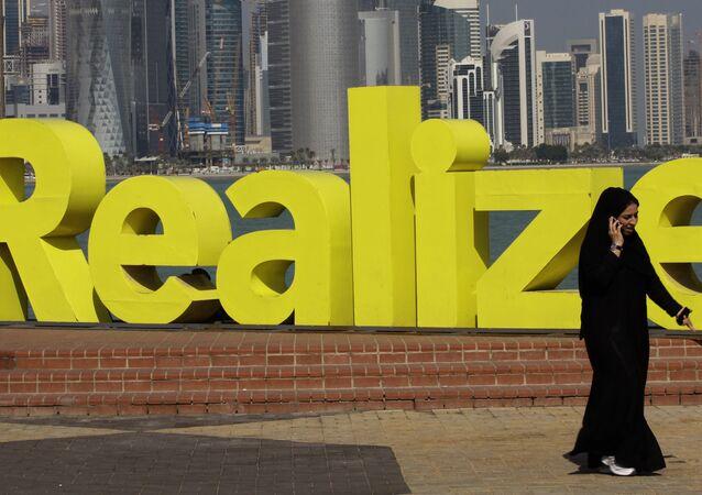A women walks at the corniche seaside, in Doha, Qatar, on Sunday Jan. 23, 2011.