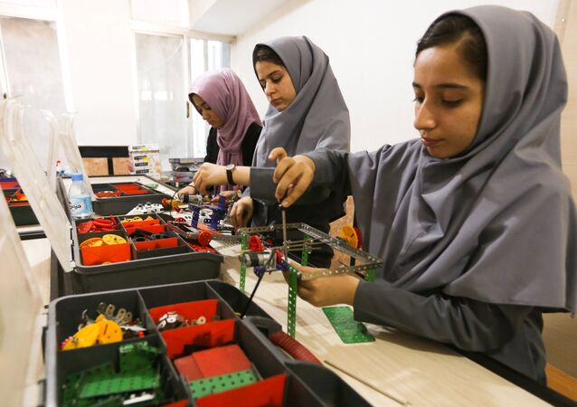 Members of Afghan robotics girls team which was denied entry into the United States for a competition, work on their robots in Herat province, Afghanistan July 4, 2017