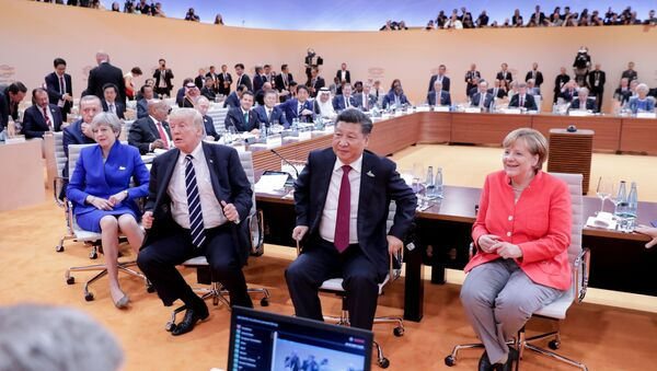 (L-R) US President Donald Trump, China's President Xi Jinping, German Chancellor Angela Merkel, Argentinia's President Mauricio Macri and Australia's Prime Minister Malcolm Turnbull turn around for photographers at the start of the first working sessionthe G20 summit in Hamburg, Germany, July 7, 2017 - Sputnik International