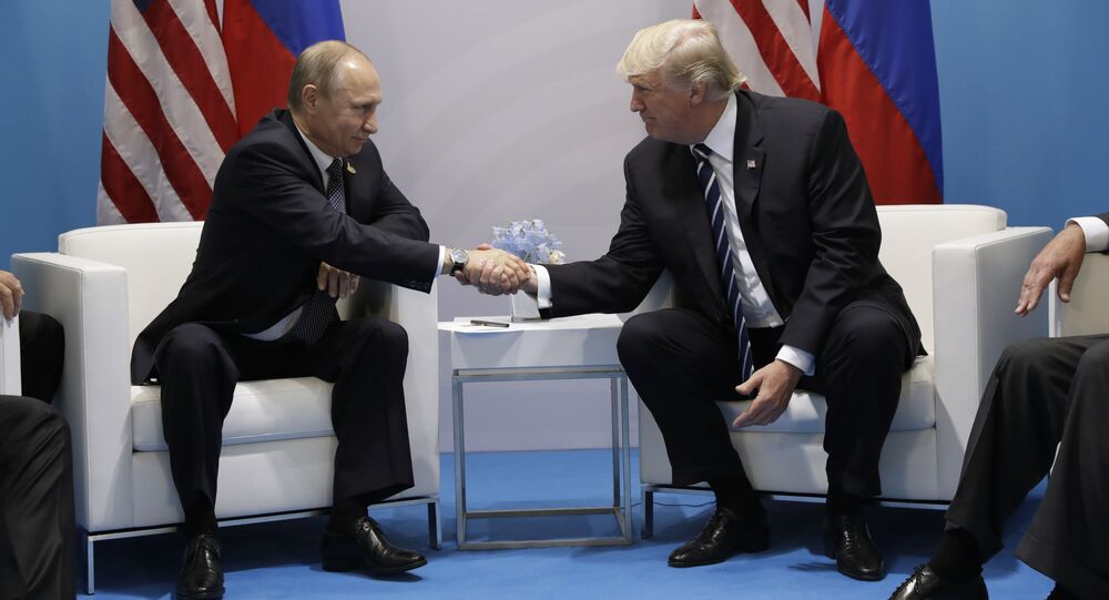 President Donald Trump shakes hands with Russian President Vladimir Putin at the G20 Summit, Friday, July 7, 2017, in Hamburg