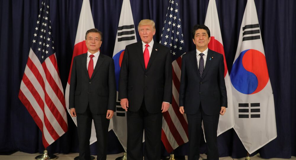 US President Donald Trump meets South Korea's President Moon Jae-In and Japanese Prime Minister Shinzo Abe ahead the G20 leaders summit in Hamburg, Germany July 6, 2017.
