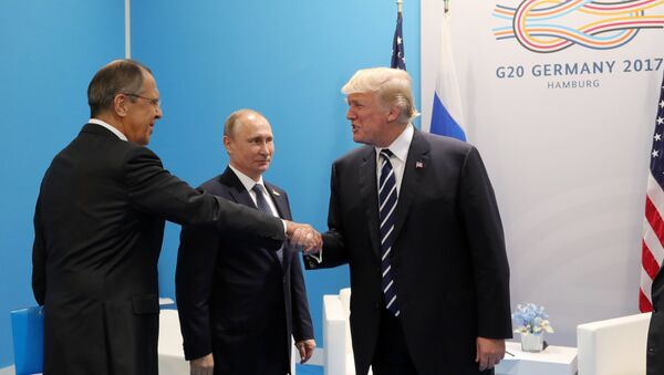 Russian President Vladimir Putin and President of the USA Donald Trump, right, talk during their meeting on the sidelines of the G20 summit in Hamburg. Left: Russian Foreign Minister Sergei Lavrov. - Sputnik International