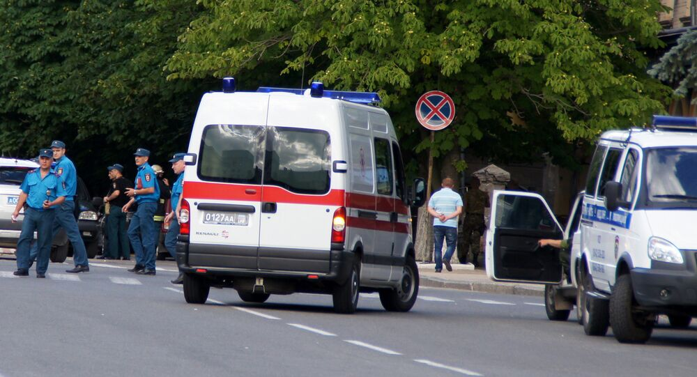 Law enforcement officers work at the site of explosions in the center of Lugansk