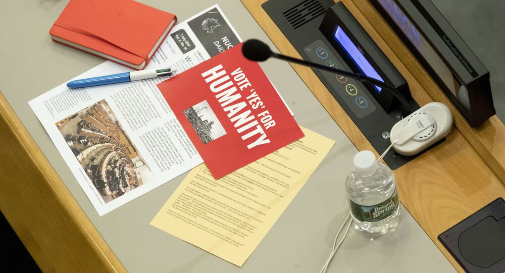Leaflets are seen on a delegates desk before a vote by the conference to adopt a legally binding instrument to prohibit nuclear weapons, leading towards their total elimination, Friday, July 7, 2017 at United Nations headquarters