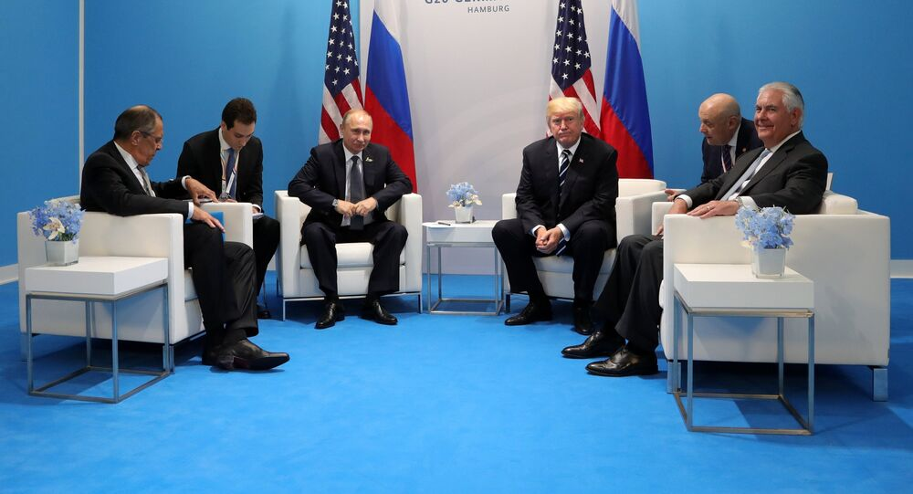 Russian President Vladimir Putin and President of the USA Donald Trump, third right, during their meeting on the sidelines of the G20 summit in Hamburg. Right: US Secretary if State Rex Tillerson; left: Russian Foreign Minister Sergei Lavrov.