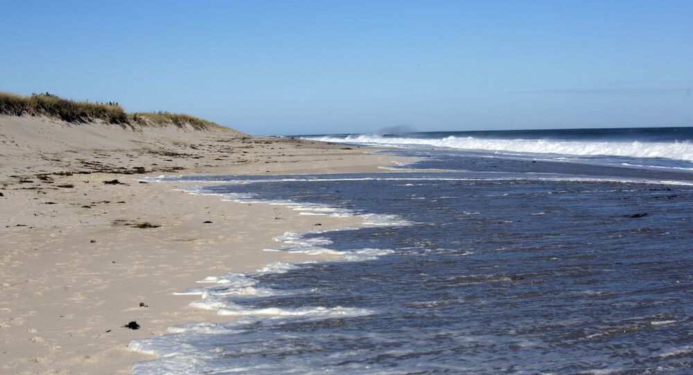 Water nearly reaches the dune barrier at Cape Cod's Ballston beach in Truro, Massachusetts.