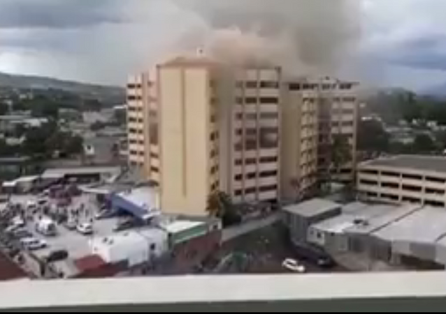 Fire erupts from third tower of El Salvador's finance ministry