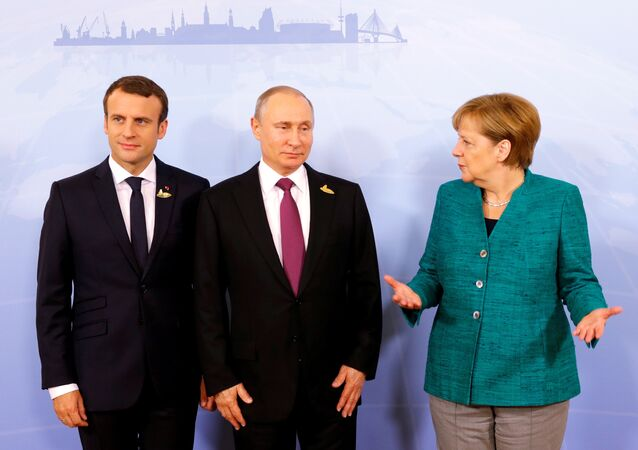 German Chancellor Angela Merkel, Russian President Vladimir Putin and French President Emmanuel Macron meet during the G20 leaders summit in Hamburg, Germany July 8, 2017