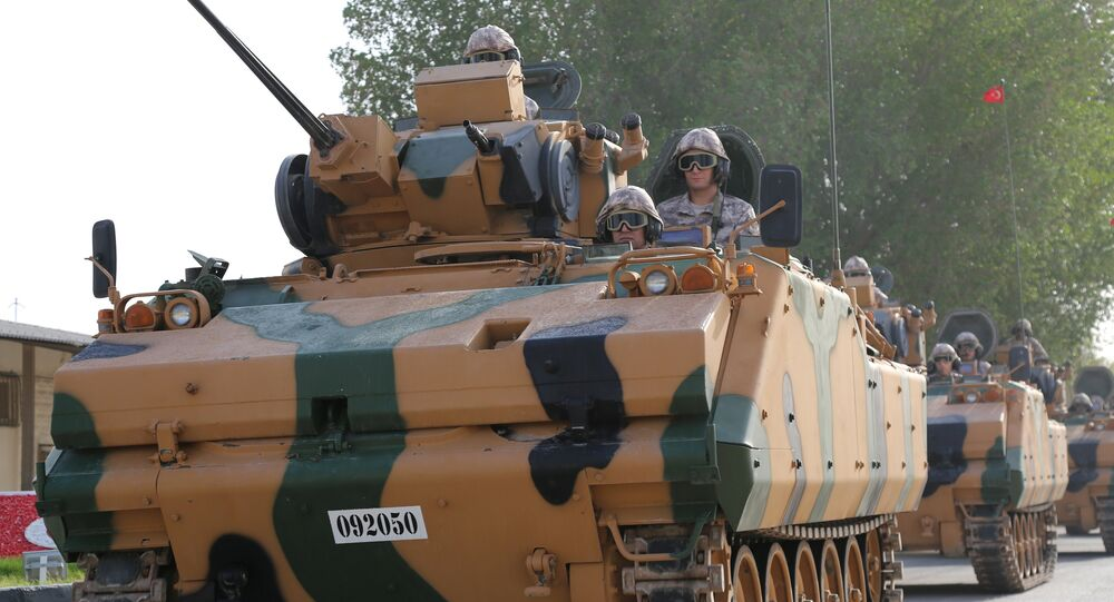 Turkish APC drives at their military base in Doha, Qatar June 18, 2017. Picture taken June 18, 2017