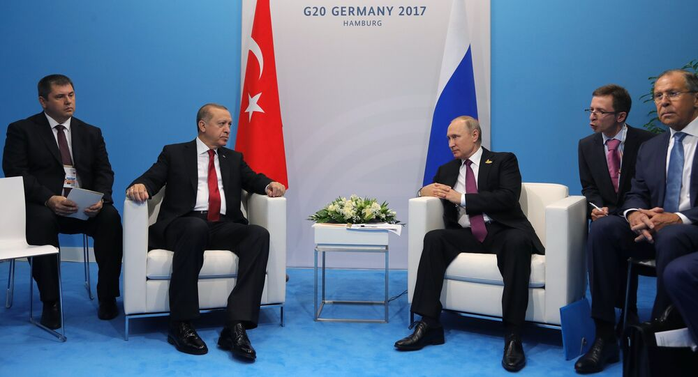 July 8, 2017. Russian President Vladimir Putin and President of Turkey Recep Tayyip Erdogan, second left, talk during their meeting on the sidelines of the G20 summit in Hamburg. Right: Russian Foreign Minister Sergei Lavrov