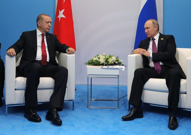 Russian President Vladimir Putin and President of Turkey Recep Tayyip Erdogan, second left, talk during their meeting on the sidelines of the G20 summit in Hamburg. Right: Russian Foreign Minister Sergei Lavrov