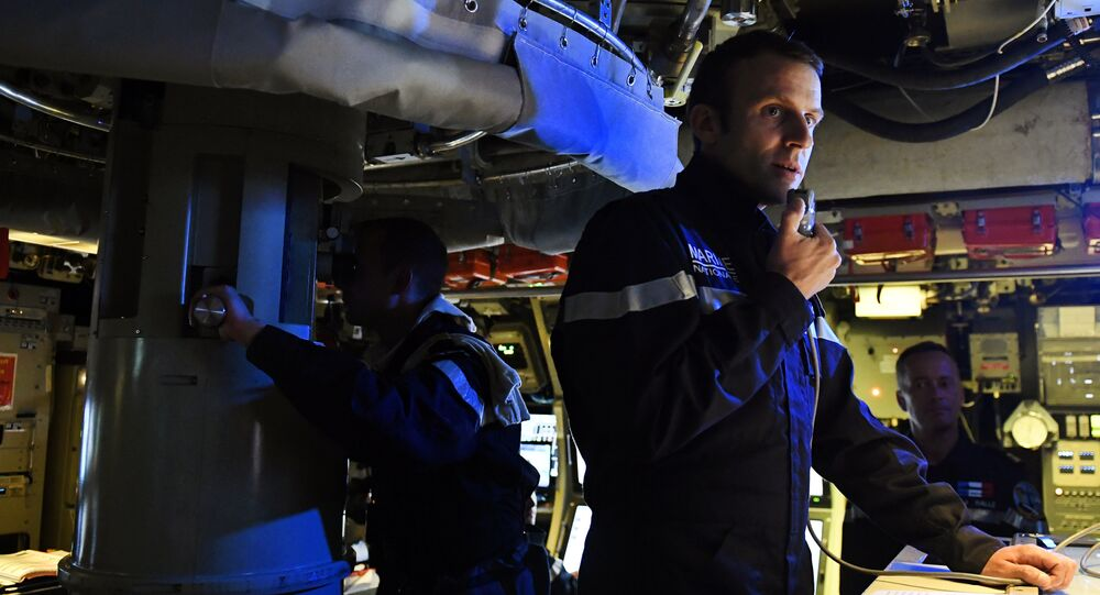 French president Emmanuel Macron speaks to the Captain and crew of the submarine Le Terrible from the operations centre of the vessel, whilst at sea on July 4, 2017. Picture taken July 4, 2017