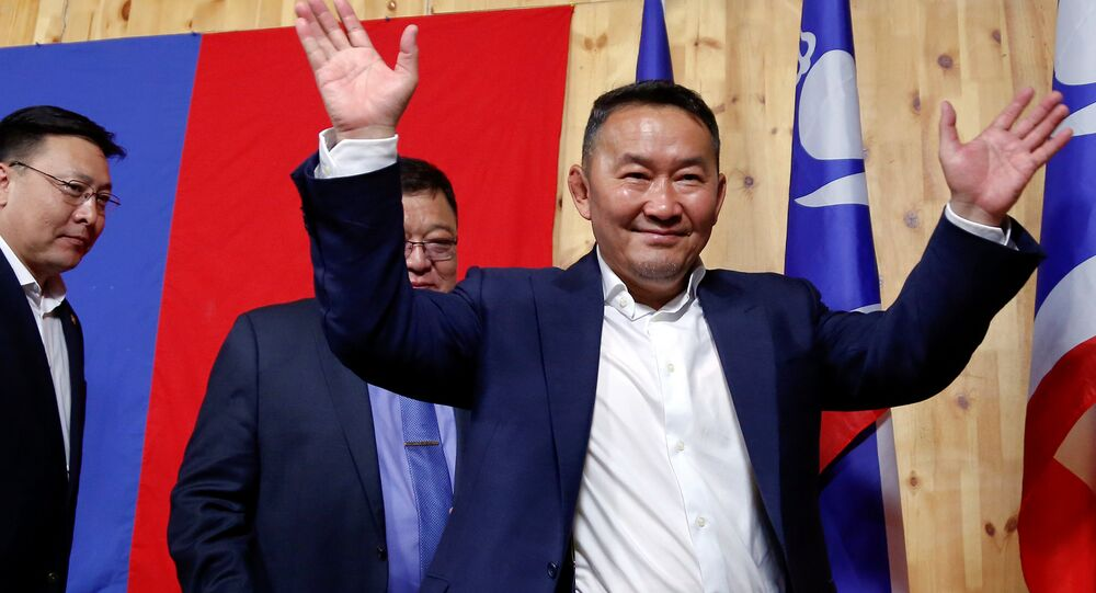 Khaltmaa Battulga, the presidential candidate of the opposition Democratic Party waves to reporters after addressing them in Ulaanbaatar, Mongolia, early July 8, 2017