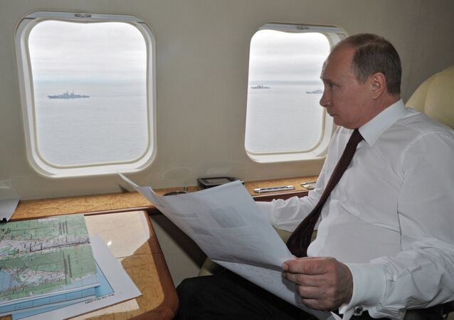 Russian President Vladimir Putin flying in a presidential aircraft