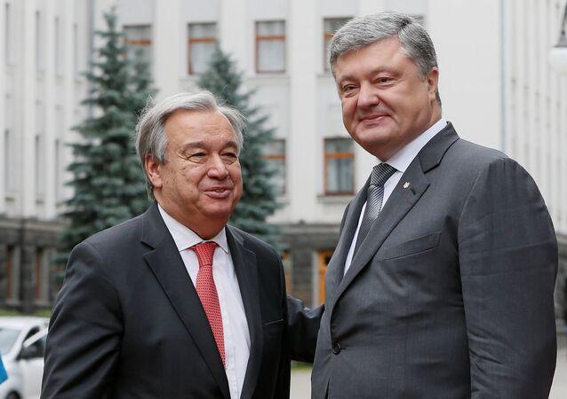 Ukrainian President Petro Poroshenko (R) greets UN Secretary General Antonio Guterres during a meeting in Kiev, Ukraine July 9, 2017