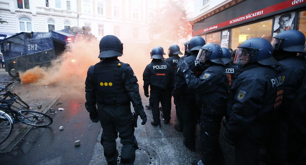 German riot police stand to guard protests during the G20 summit in Hamburg, Germany, July 7, 2017