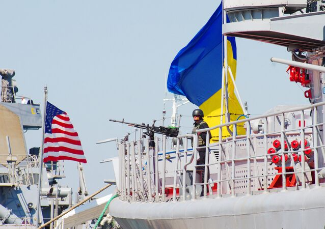 The Ukrainian Navy Hetman Sahaidachnyi frigate (R) and United States Navy missile destroyer Donald Cook (DDG-75) are moored near one another during the international drill Sea Breeze-2015 which officially begins in southern Ukrainian city of Odessa, on September 1, 2015.