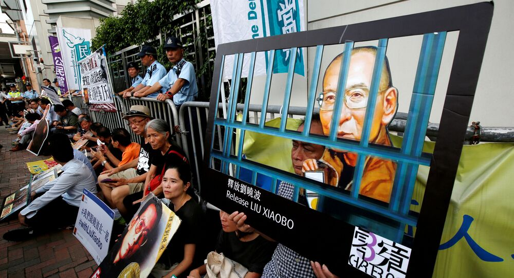 Pro-democracy activists stage a sit-in protest demanding the release of Nobel laureate Liu Xiaobo, outside China's Liaison Office in Hong Kong, China July 10, 2017.