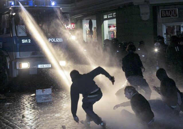 Police use water canons to quell street violence following a street festival, called Schanzenfest street festival which started peacefully in Hamburg, northern Germany, early Sunday Sept. 13, 2009.