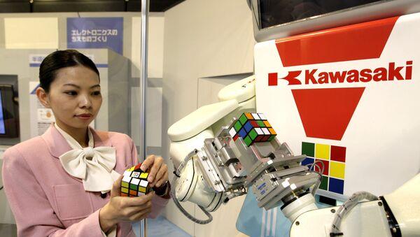 Japan's machinery maker Kawasaki Heavy Industries robot Cube-kun is seen solving a 3x3x3 Rubik's Cube during a demonstration in Tokyo - Sputnik International