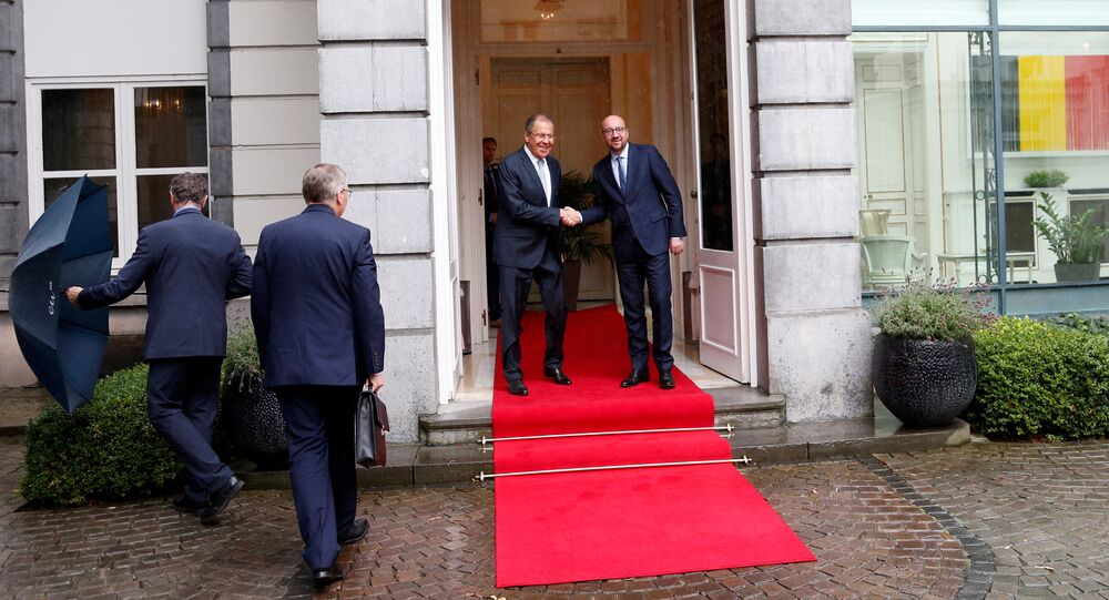 Russian Foreign Minister Sergei Lavrov poses with Belgian Prime Minister Charles Michel ahead of a meeting in Brussels, Belgium, July 12, 2017.