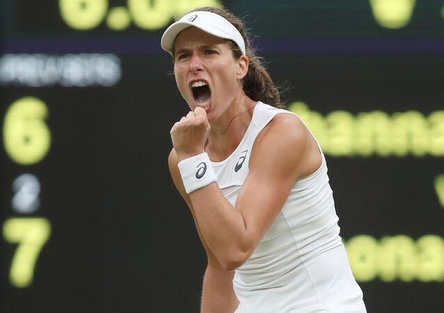 Great Britain's Johanna Konta celebrates winning the second set during the quarter final match against Romania's Simona Halep, July 11, 2017.