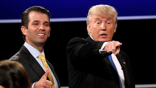 Donald Trump Jr. (L) gives a thumbs up beside his father Republican U.S. presidential nominee Donald Trump (R) after Trump's debate against Democratic nominee Hillary Clinton at Hofstra University in Hempstead, New York, U.S. September 26, 2016. - Sputnik International