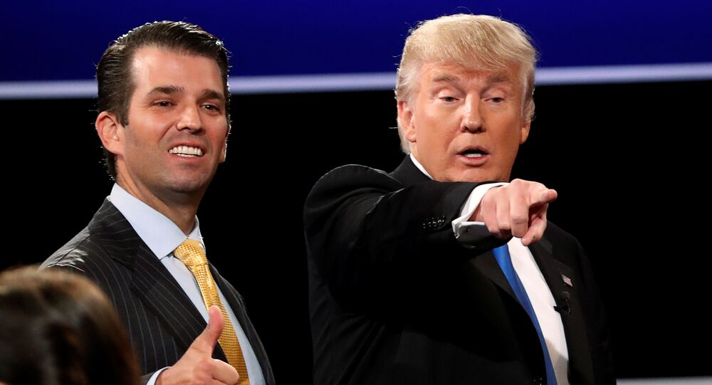 Donald Trump Jr. (L) gives a thumbs up beside his father Republican U.S. presidential nominee Donald Trump (R) after Trump's debate against Democratic nominee Hillary Clinton at Hofstra University in Hempstead, New York, U.S. September 26, 2016.