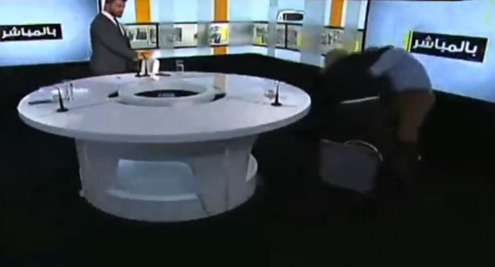 A brawl between Syrian MP Ahmad Shalash and Lebanese Sunni Islamist cleric Bilal Duqmaq breaks out on Lebanese talk show Bel Moubashar.