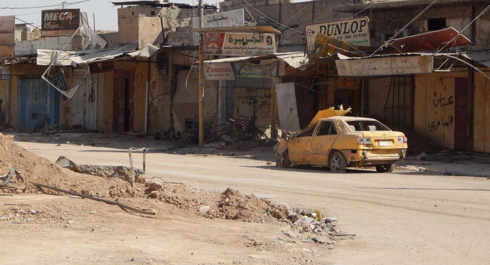 Wrecked car in Western Mosul, Iraq