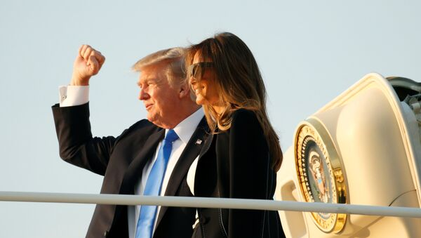 U.S. President Donald Trump and first lady Melania Trump board Air Force One as they depart Joint Base Andrews in Maryland, U.S., enroute to Paris July 12, 2017. - Sputnik International