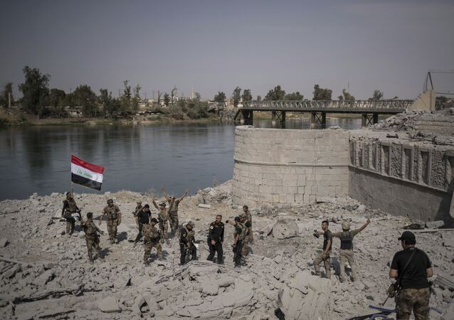 Iraqi Special Forces soldiers celebrate after reaching the bank of the Tigris river as their fight against Islamic State militants continues in parts of the Old City of Mosul, Iraq, Sunday, July 9, 2017.