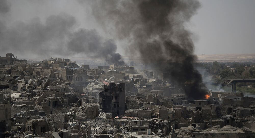 Smoke billows after airstrikes hit Islamic State positions on the edge of the Old City a day after Iraq's prime minister declared total victory in Mosul, Iraq, Tuesday, July 11, 2017.