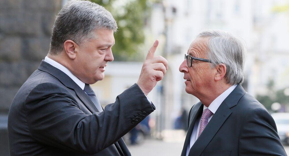 Ukrainian President Petro Poroshenko talks to European Commission President Jean-Claude Juncker before the EU-Ukraine summit in Kiev, Ukraine, July 13, 2017.