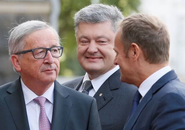 European Commission President Jean-Claude Juncker, Ukrainian President Petro Poroshenko and European Council President Donald Tusk walk before the EU-Ukraine summit in Kiev, Ukraine, July 13, 2017.