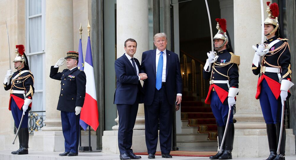 French President Emmanuel Macron greets U.S. President Donald Trump at the Elysee Palace in Paris, France, July 13, 2017.