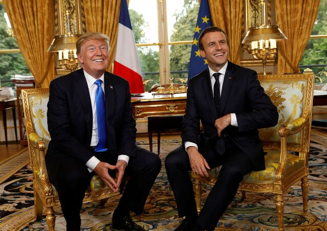 French President Emmanuel Macron and U.S. President Donald Trump (L) react as they meet at the Elysee Palace in Paris, France, July 13, 2017.